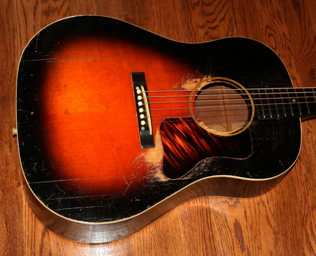1938 Gibson J-35 Sunburst, Very Good, Hard, $6,995.00