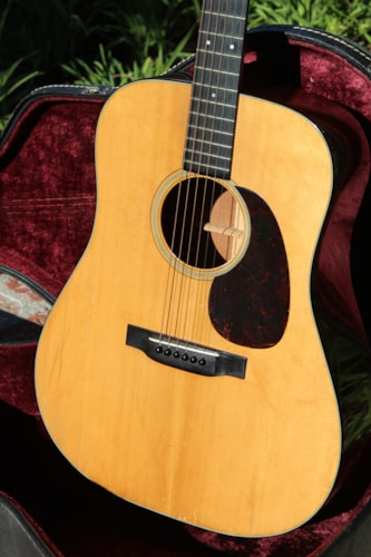 1944 Martin D-18 in very good condition with original case. Scalloped braces.