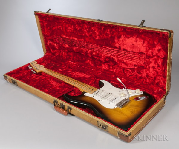 1954 Fender Stratocaster Sunburst, Very Good, Original Hard, $35,670.00