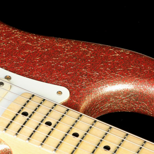 1957 Fender Custom Shop 1957 Stratocaster Heavy Relic Gold Sparkle over Red Base Excellent, $3,600.00