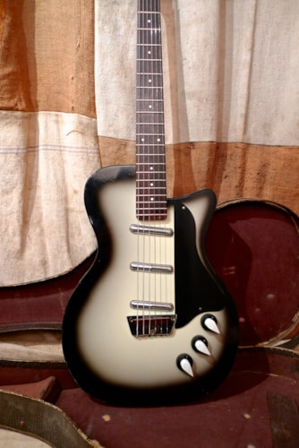 1958 Silvertone by Danelectro Model 1305 U3 Silverburst, Very Good, Original Soft, $2,400.00