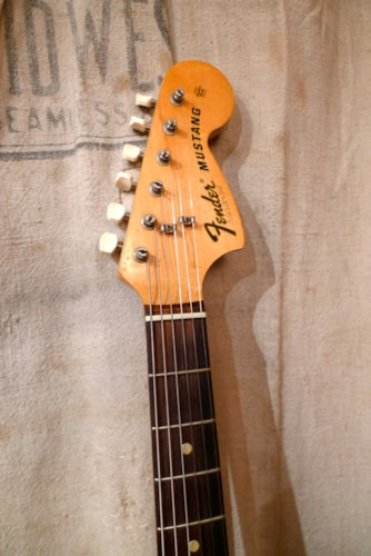 1974 Fender Mustang Sunburst, Very Good, Original Hard, $1,450.00