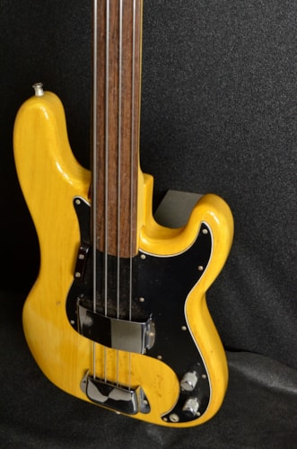 1976 Fender® Precision Bass-Fretless Natural, Very Good, Hard, $1,599.00