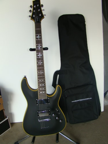 2009 Schecter Hellraiser (X-inlay)