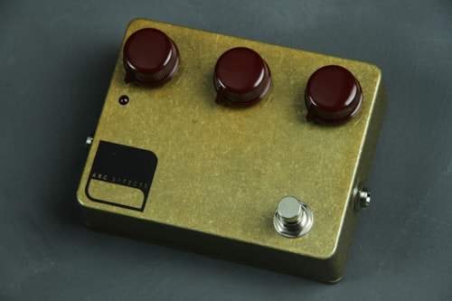 Arc Limited Release Trans Gold finish w/ Oxblood Dakaware knobs